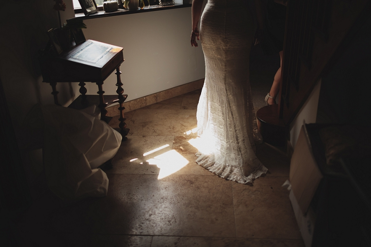 Soft light on brides wedding dress before her wedding at St Mary's church in Stansted Kent
