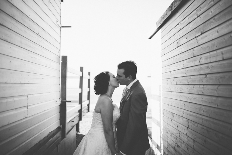 Bride and Groom kissing on Whitstable, Kent beach