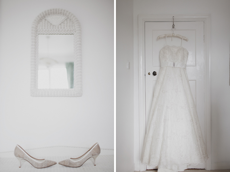 Wedding shoes and dress hanging on door