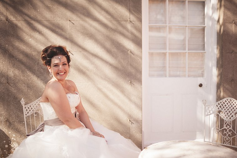 A photograph of a bride sat in shade at Swarling Manor near Canterbury in Kent