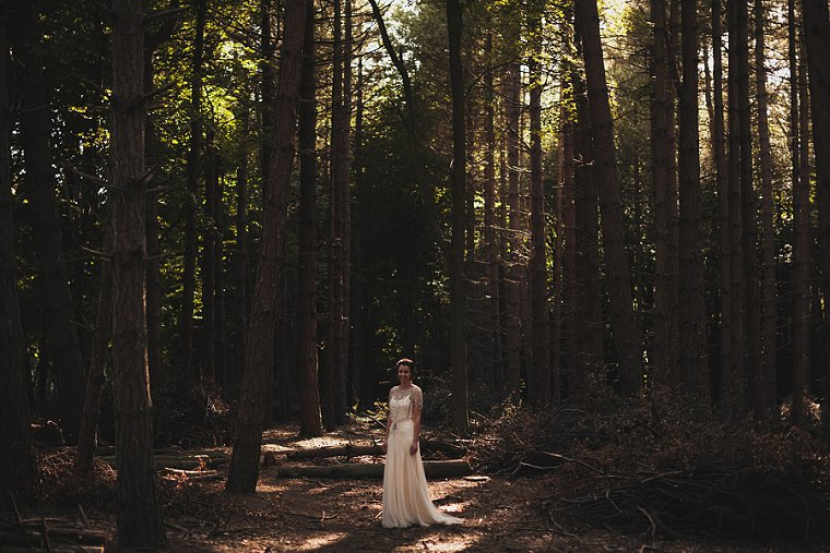 Bride stood in a forest in Kent photographed by Kent Wedding Photographer Paul Fuller