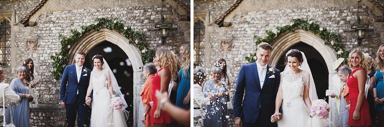 Bride and Groom leaving the church and wedding guests throwing confetti