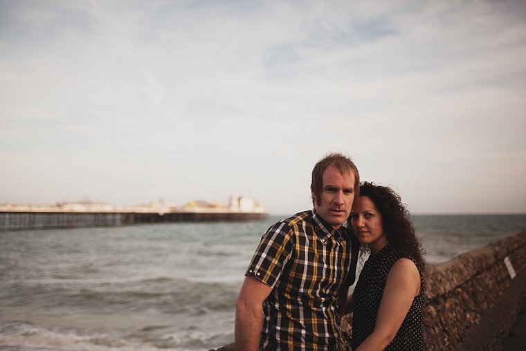 Engagement photo of couple on Brighton Beach with Brighton pier in the backgrounf