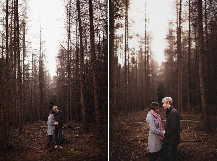 Kyla and Tom hugging each other in a woodland during a pre wedding shoot