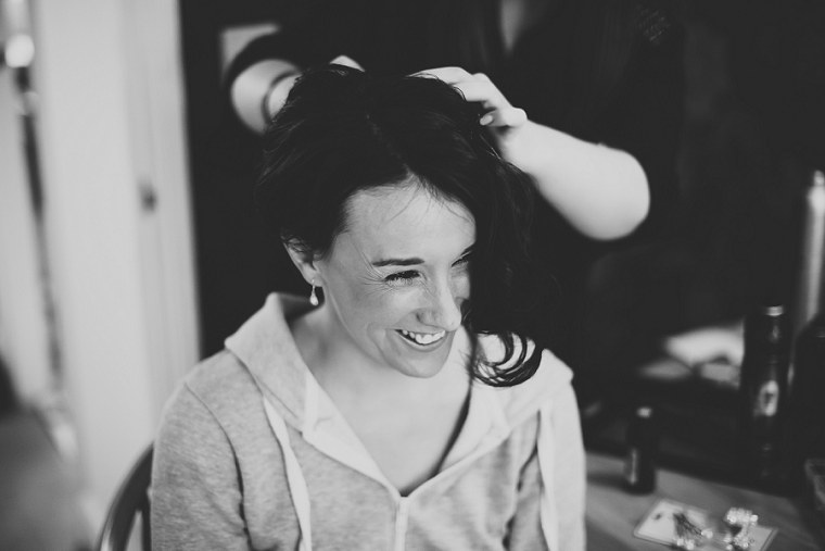 Bride having her hair done before her wedding day