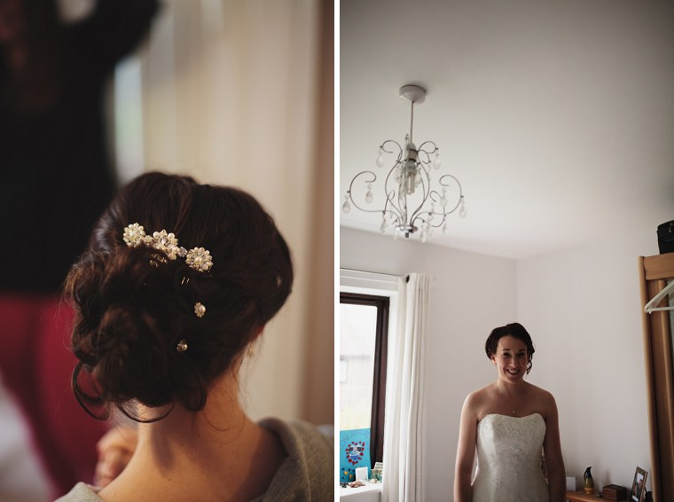 Bride in her white dress as she gets ready for her wedding
