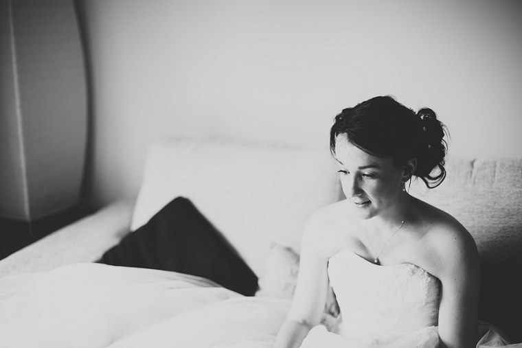 Black and White Photograph of a bride in her wedding dress waiting to leave for her wedding at Nettlestead Place in Kent