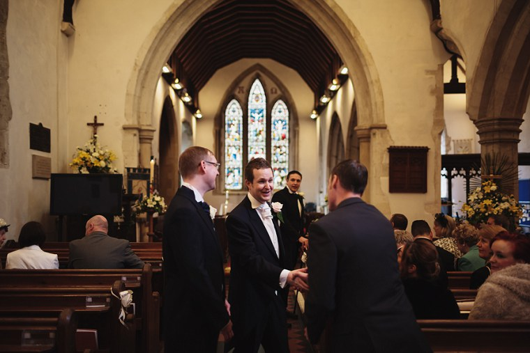 Groom shaking hands with a wedding guest