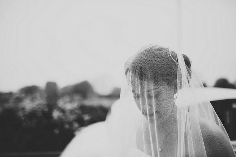 Black and white wedding photography of bride through her veil