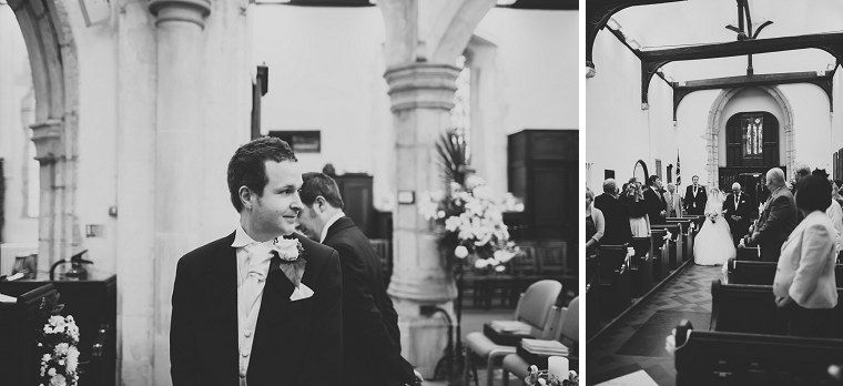 Groom turning back to look as bride enters the church