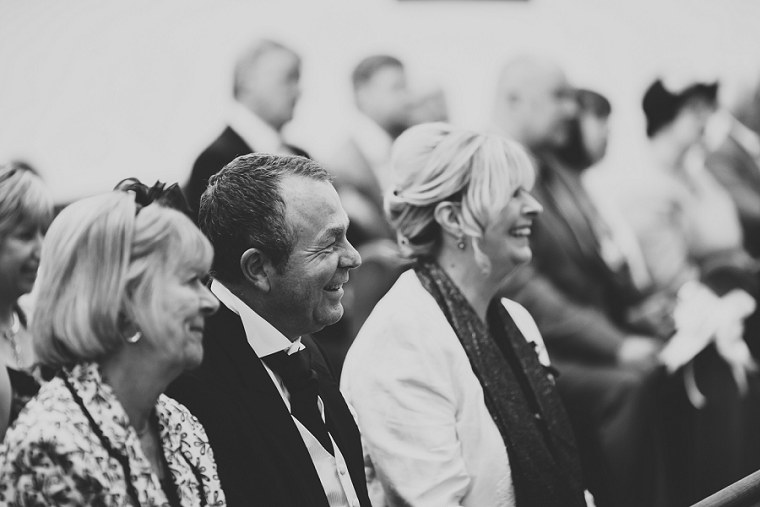 Father of the groom laughing during the wedding ceremony