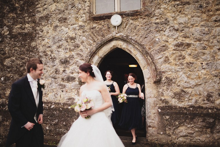 Bridesmaids exiting St Mary's church in Kent