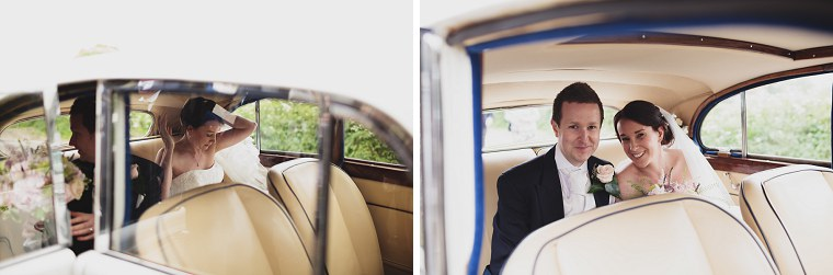 Bride and groom sitting in white rolls royce wedding car