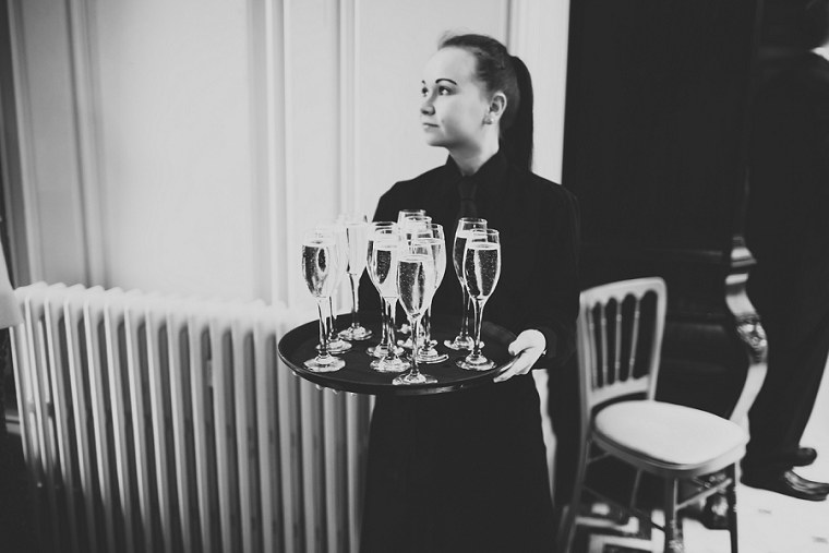 Waitress holding glasses of Champagne at Mount Ephraim