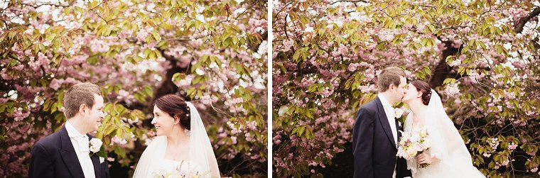 Wedding portrait of wedding couple in front of a blossom tree at Mount Ephraim