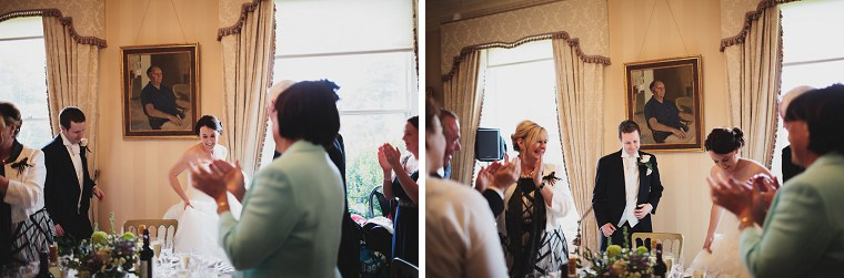Wedding guests applauding wedding couple at the start of the wedding breakfast at Mount Ephraim Gardens in Kent