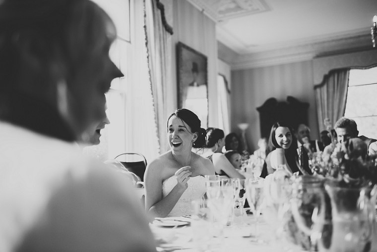 Bride looking happy during wedding speeches