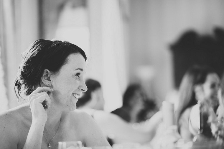 Black and White photograph of bride at Mount Ephraim Gardens smiling during the speeches