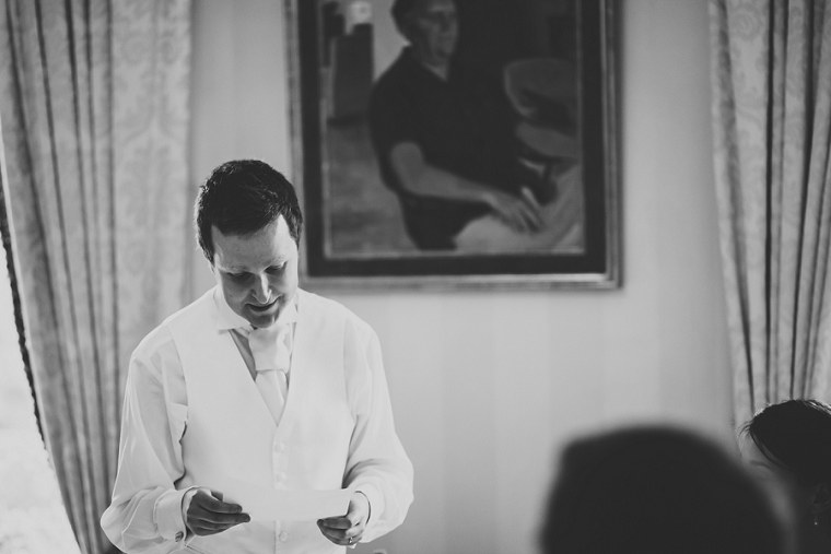 Black and white wedding photography of groom giving his speech at Mount Ephraim Gardens in Kent