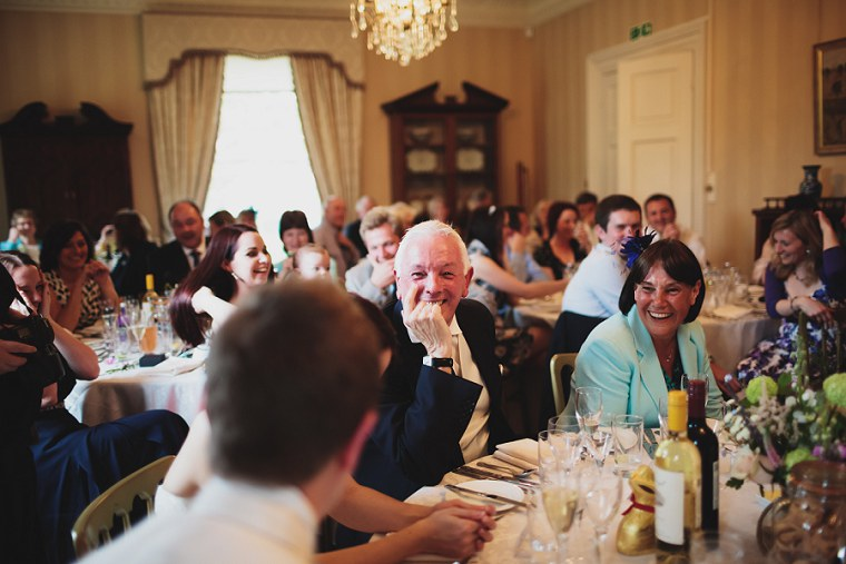 father of the bride laughing during the best mans speech
