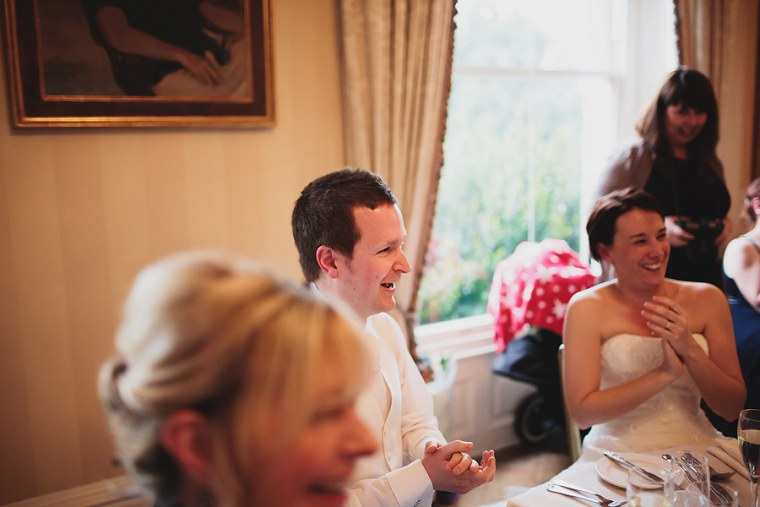 groom laughing during the best mans wedding speech