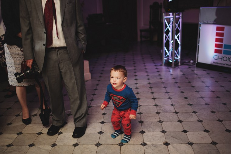 Young boy dancing during wedding reception