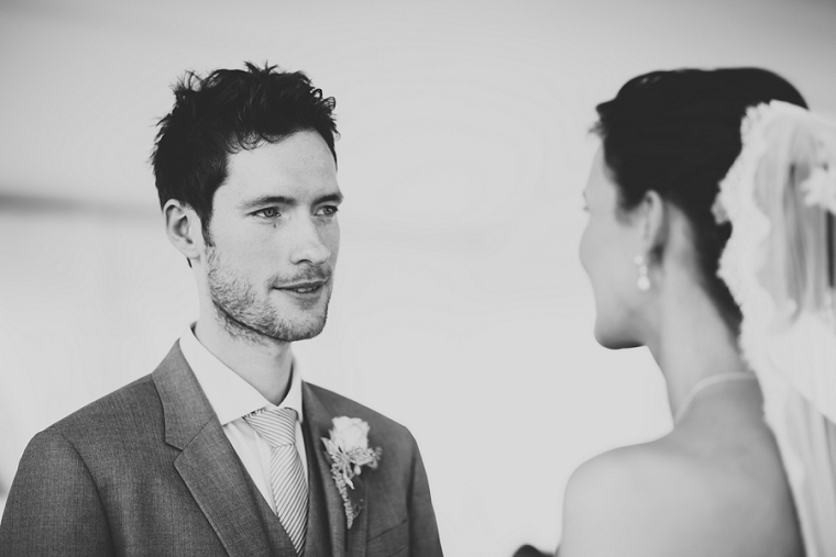 Groom looking it to the eyes of the bride during wedding service at Chilston Park Hotel