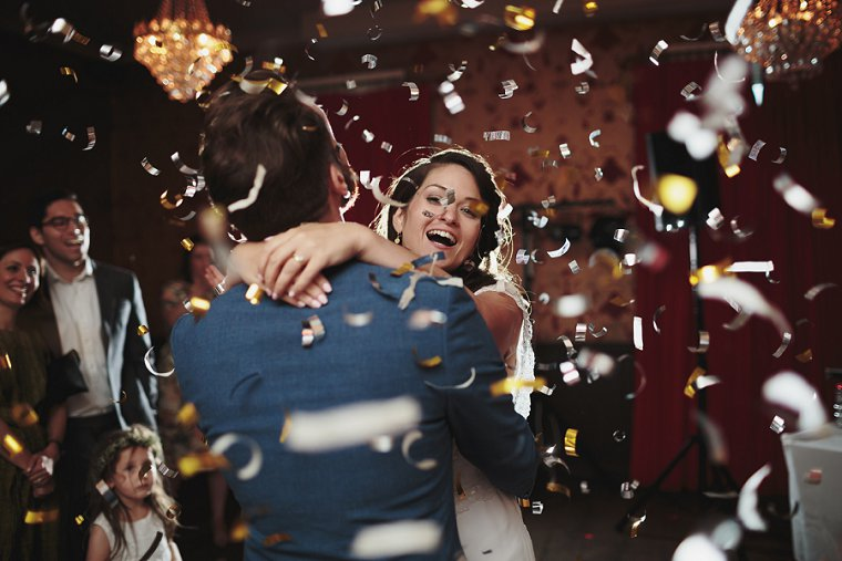 bride and groom first dance with confetti cannon