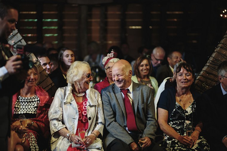 Wedding guests laughing during best man speeches