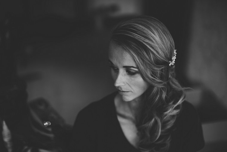 black and white image of bride getting ready for her Squerryes Court wedding