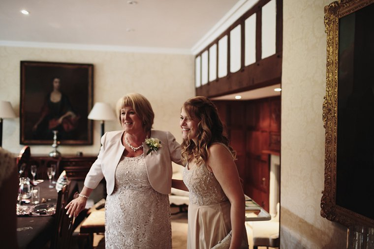 mother of bride hugging bridesmaid