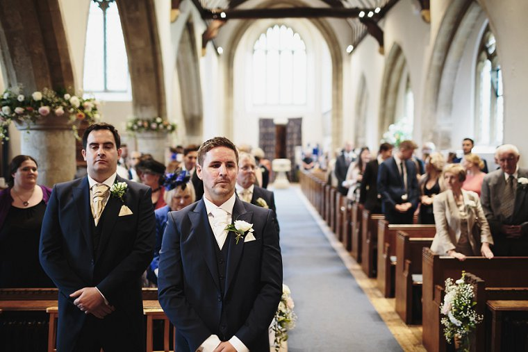 Groom waiting for bride at front of the church