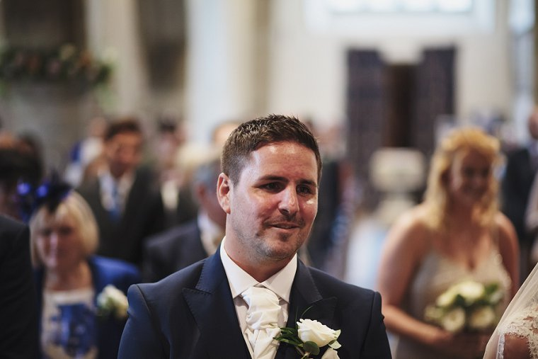 Groom smiling before his wedding