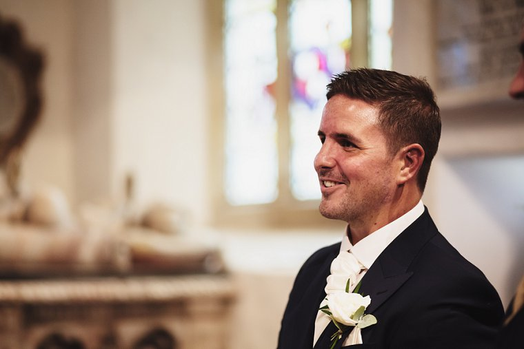 Groom smiling after wedding service