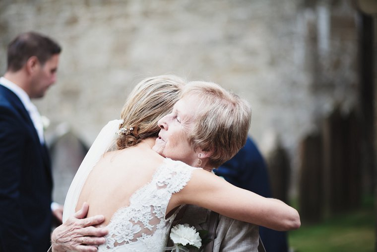 Bride hugging wedding guest