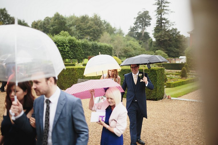 Rainy wedding day guests in Kent