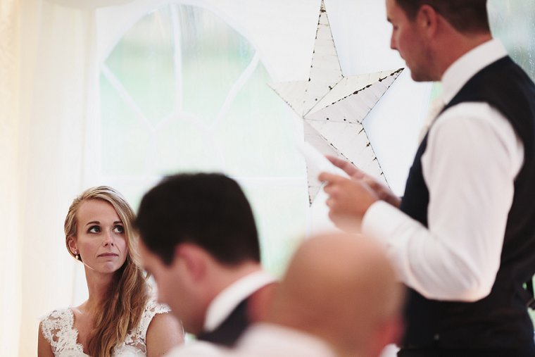 Bride looking at Groom during Grooms speech