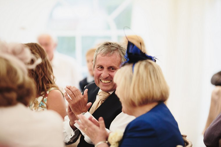Father of groom laughing during the best mans speech