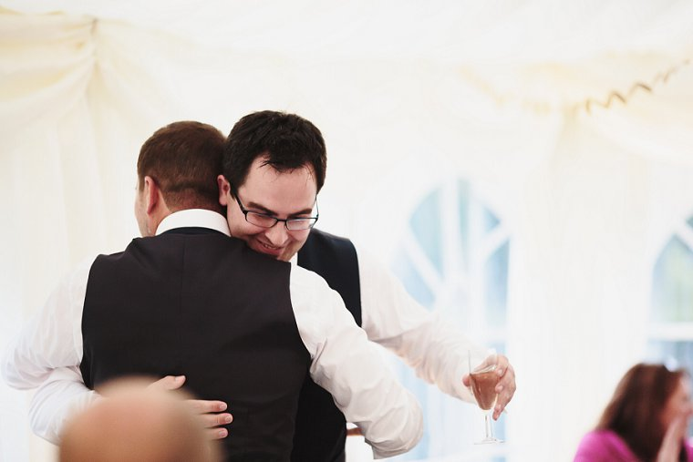 Groom and Best Man hug after his speech