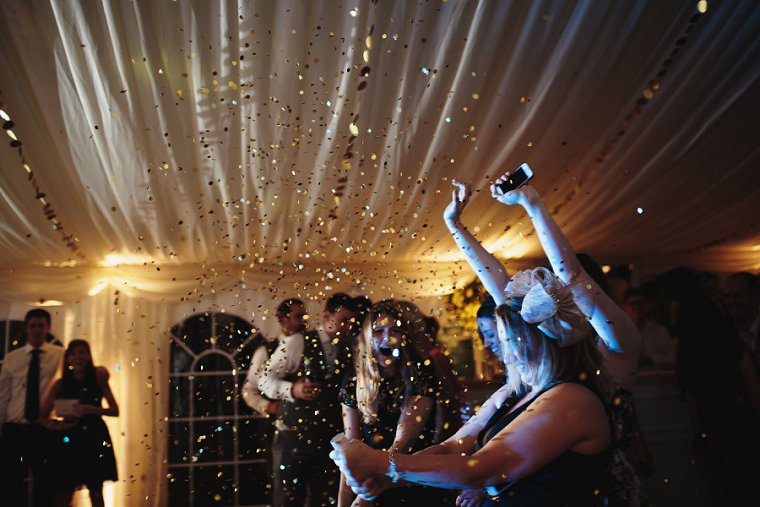 Indoor confetti cannon at wedding