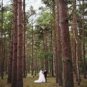Kent Wedding Photographer Reviews Bride and Groom in Woods