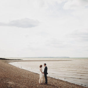 Bride and Groom Posing for their wedding photography at East Quay in Whitstable