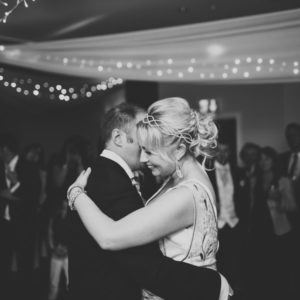Bride and Groom dancing together after their Kent wedding