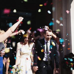 Bride and Groom showered in colorful confetti