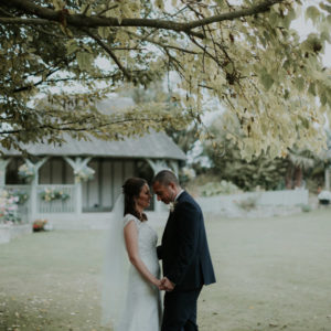 Bride and Groom holding hands under a tree after their wedding, Kent Wedding Photography Reviews
