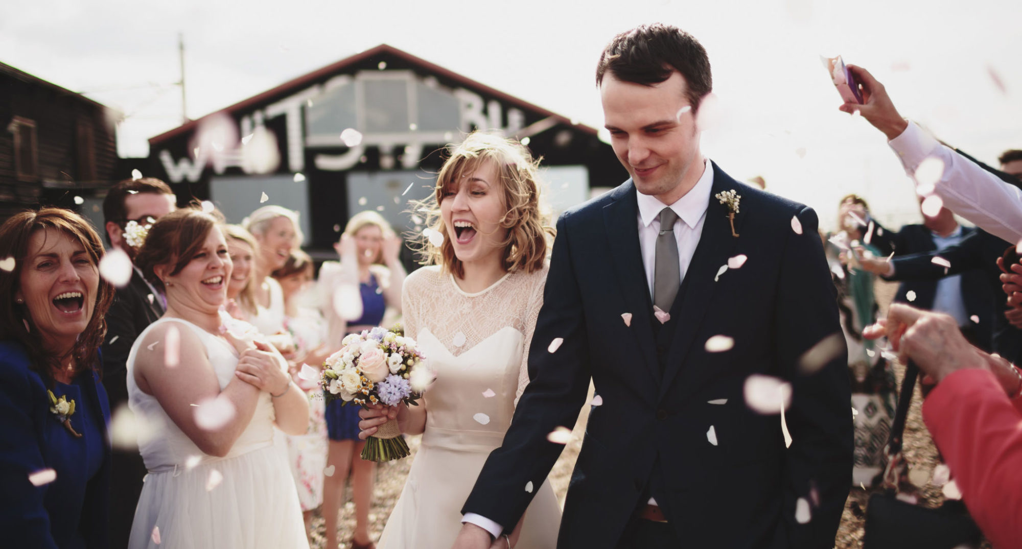 Bride and Groom showered in confetti after their wedding at East Quay in Kent