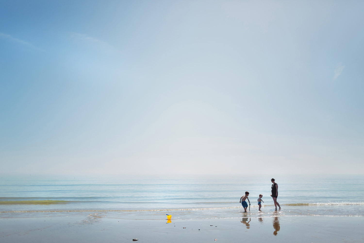 Family Portrait of mother with her children playing on a beach in Kent