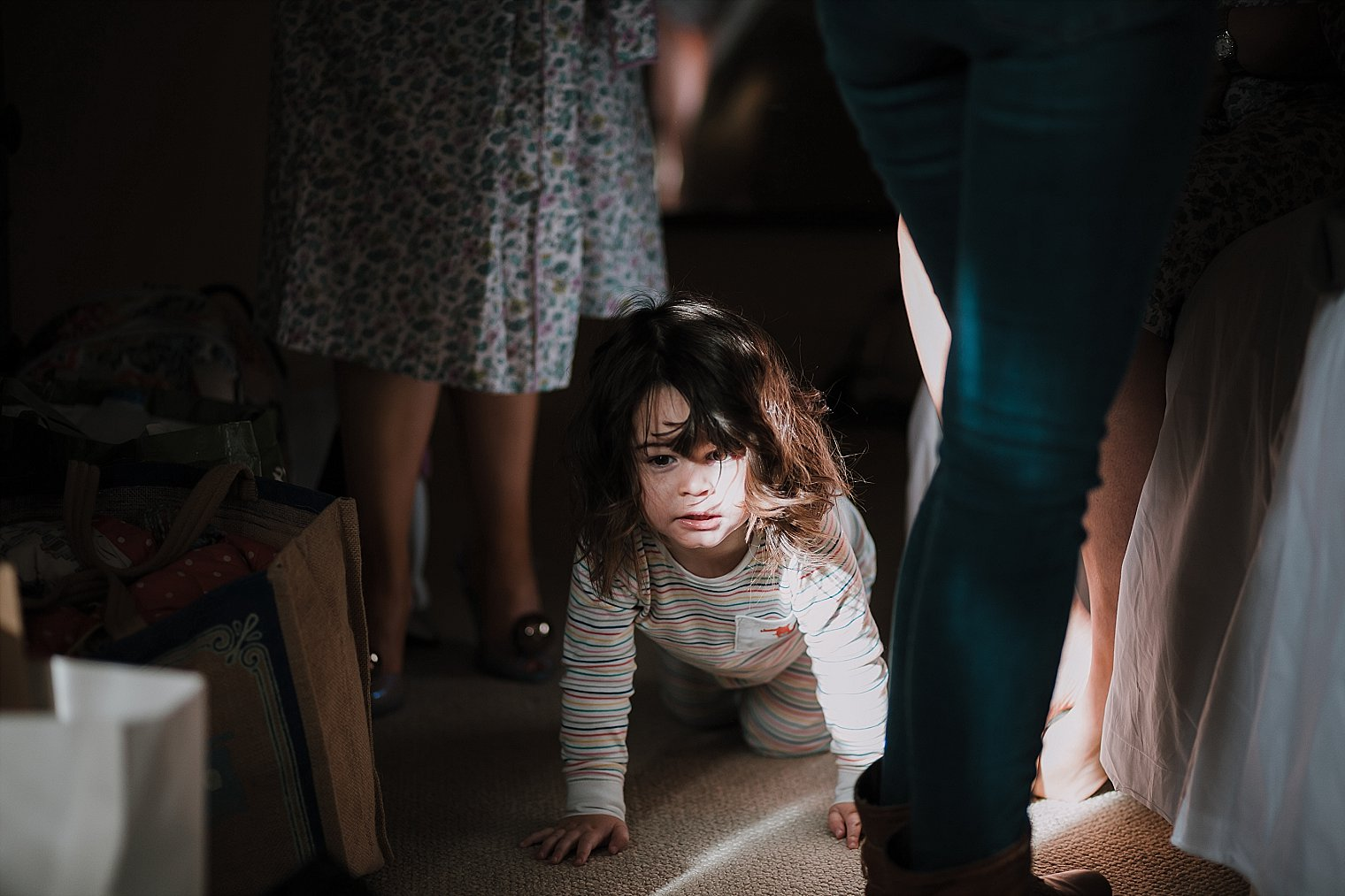 Brides daughter crawling on floor