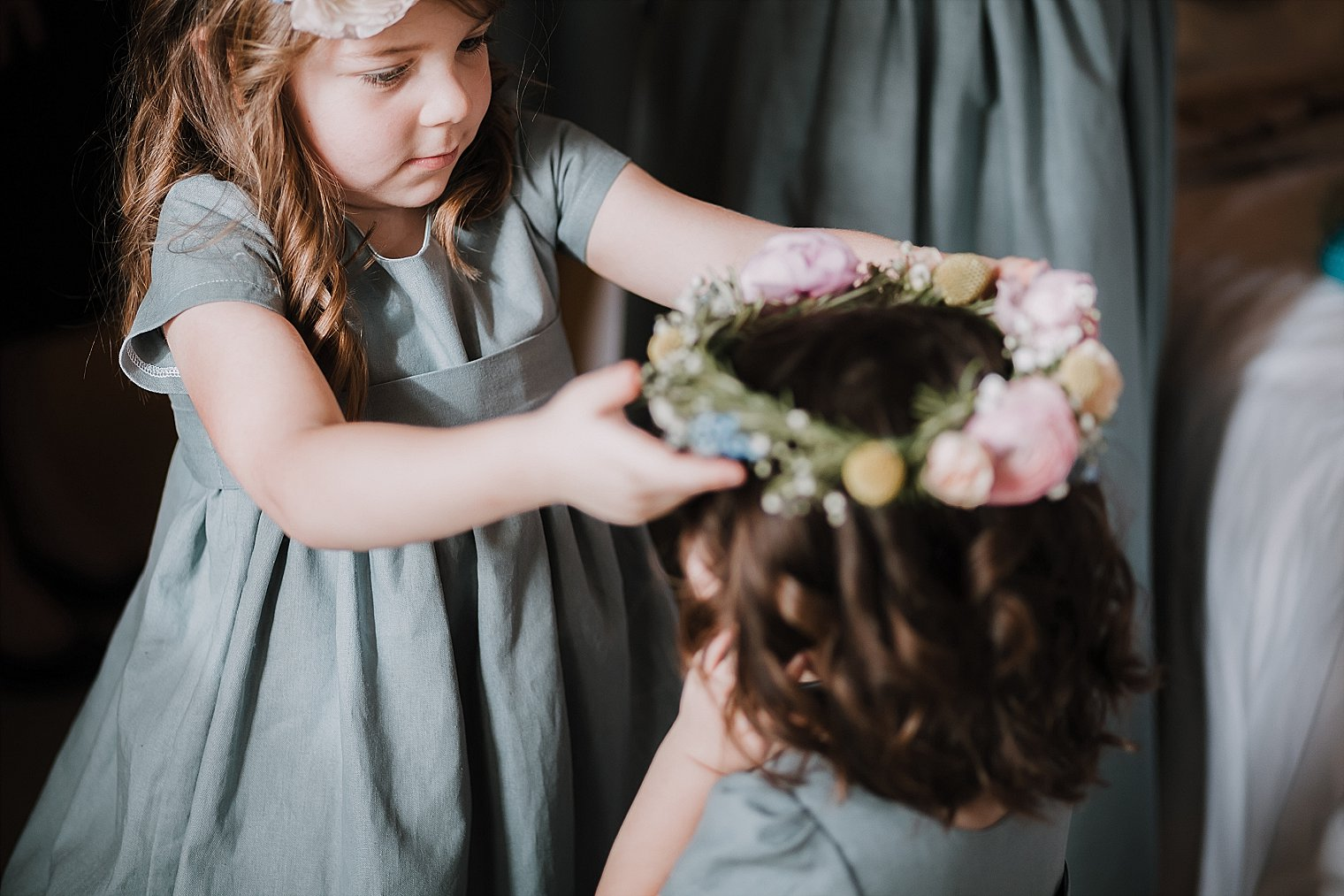 2 flowergirls getting dressed