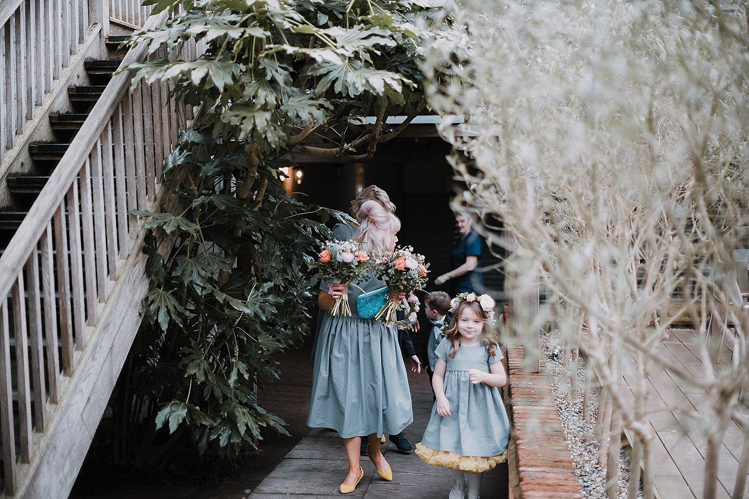 bridesmaid and flower girl walking together